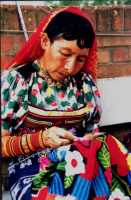 Kuna woman sewing a mola